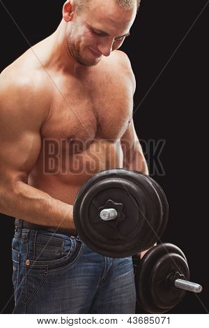 man excersizing with dumbbells