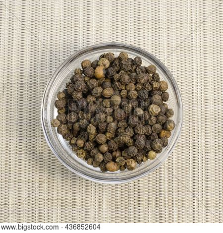 Pile Of Black Peppercorns Black Pepper Dried Seeds On Bamboo Wooden Background Close Up Top View