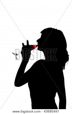silhouette, woman drinks wine from wine glass