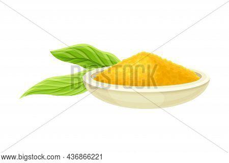 Turmeric Or Curcuma Longa Powder Used In Asian Cuisine Piled In Bowl With Green Leaf Nearby Closeup