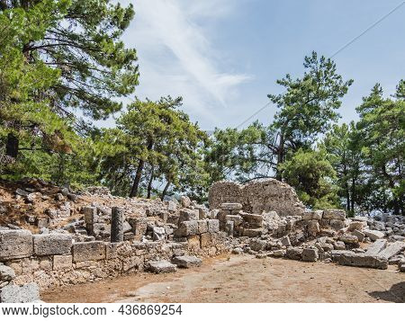 Ruins Of Ancient City Phaselis. Stones Of Damaged Buildings And Archaeological Excavations Outdoors