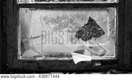 Monochrome. Horror, Halloween. Smashed Glass Window With Old Wooden Frame. Old Window. Finely Broken