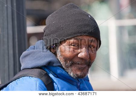 Happy homeless african american man outdoors during the day. poster