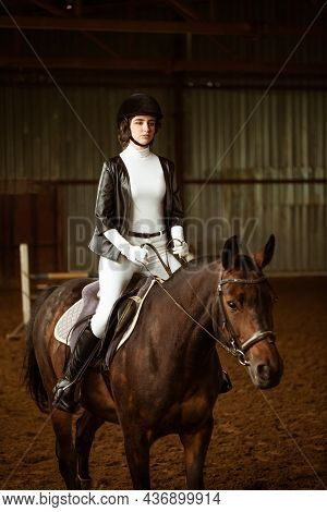 Young Woman Rider On Dressage Horse. An Abstract Shot Of Horse During Competition. Cute Girl Jockey