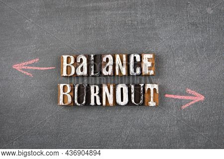 Balance And Burnout Concept. Wooden Letters On A Chalk Board