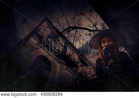 Halloween Witch Holding Black Face Mask Standing Over Grunge Castle, Dead Tree, Bird Fly, Full Moon
