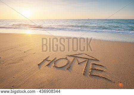 Sea and home on the sea sand. Nature and conceptual composition.