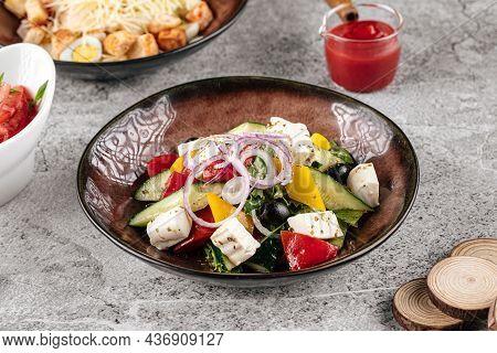 Portion Of Fresh Greek Salad On Gray Backgound