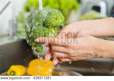 Close Up Asian Young Woman Washing Broccoli, Tomato, Carrot Fresh Vegetables, Paprika With Splash Wa