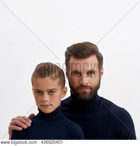 Narrow Shot Image Portrait Of Happy Young Caucasian Father And Small Teen Son Isolated On White Stud