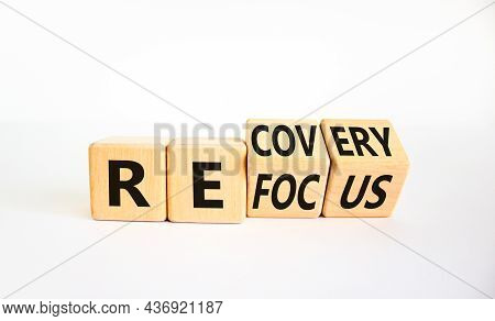 Refocus And Recovery Symbol. Businessman Turned Cubes And Changed The Word 'refocus' To 'recovery'.