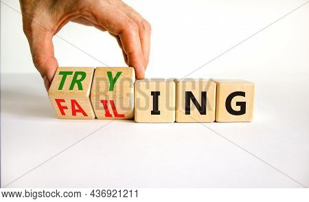 Failing Or Trying Symbol. Businessman Turns Wooden Cubes And Changes The Word 'failing' To 'trying'.