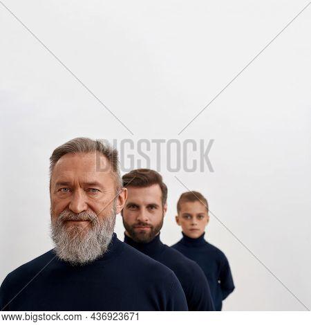 Narrow Crop Shot Portrait Of Three Family Generations Of Caucasian Men Isolated On White Studio Back