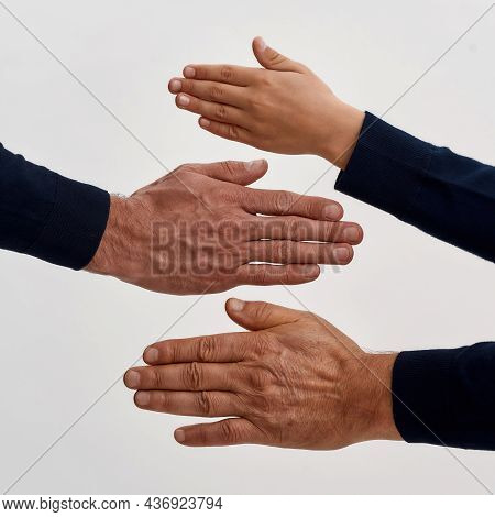 Close Up Crop Vertical Narrow Shot Of Three Generation Of Men Show Palms Hands Isolated On White Stu