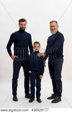 Narrow Vertical Shot Portrait Of Smiling Three Generations Of Men Pose Together Isolated On White St