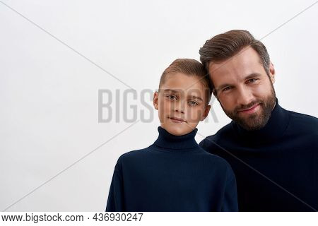 Portrait Of Smiling Young Caucasian Dad And Teen Small Son Isolated On White Studio Background Show