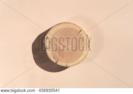 Woodcut Lying On A Trendy Beige Background. A Wooden Platform For Luxury And Natural Cosmetics Or Pr