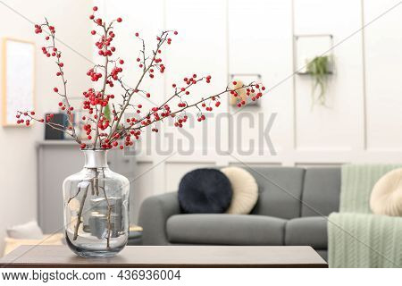 Hawthorn Branches With Red Berries On Table In Living Room, Space For Text
