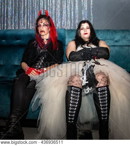 Minsk. Belarus.10.10.2021. Halloween Party. Two Girls In Scary Outfits With Red Devil Horns And Prof