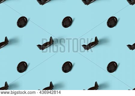 A Pattern Of Photo Accessories - Lens Caps And Lens Hoods.