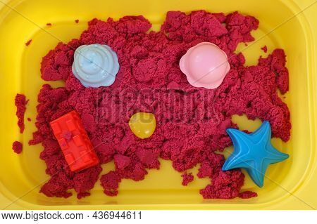 Bright Kinetic Sand And Toys In Yellow Basin, Top View