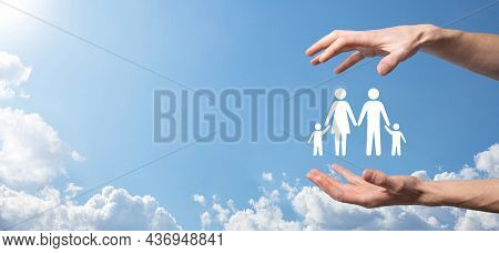 Hand On Sky Background Holds Family Icon.healthcare And Life Insurance Concept.father, Mother, Daugh