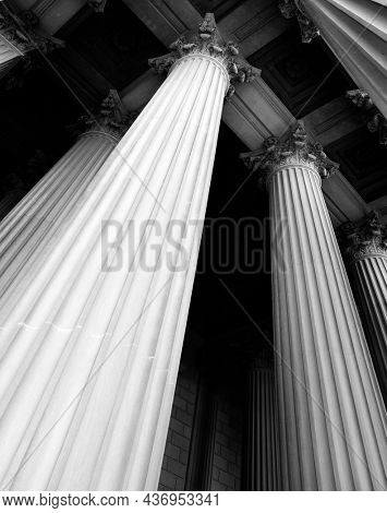 Columns on museum or courthouse building representing strength and support