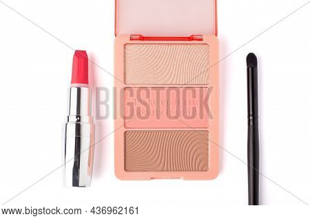 Set Of Nude Pink And Peach Color Eyeshadow In A Palette With Lipstick And Makeup Brush Isolated On W
