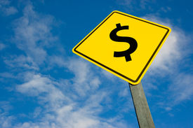Dollar On Road Sign.