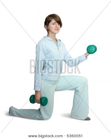 Girl In Blue Gym Clothes With Barbell