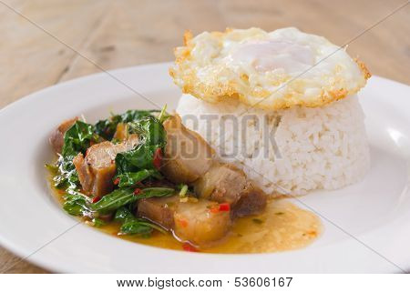 Rice And Stir Fried Basil With Crispy Pork And Fried Egg