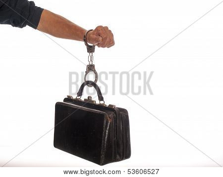 businessman with briefcase and handcuffs in his hand