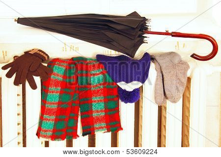 Winter Clothes On A Radiator.