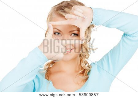 business and photography concept - woman creating a frame with fingers or snapshot
