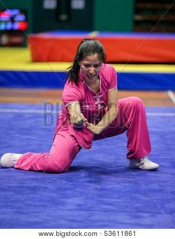 KUALA LUMPUR - NOV 03: Elizabeth Lim of Australia shows her fighting style in the 'Nan quan compulsory' event at the 12th World Wushu Championship on November 03, 2013 in Kuala Lumpur, Malaysia.