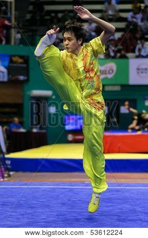 KUALA LUMPUR - NOV 03: Yeap Wai Kin of Malaysia shows a wushu high kick in the 'changquan compulsory' event at the 12th World Wushu Championship on November 03, 2013 in Kuala Lumpur, Malaysia.