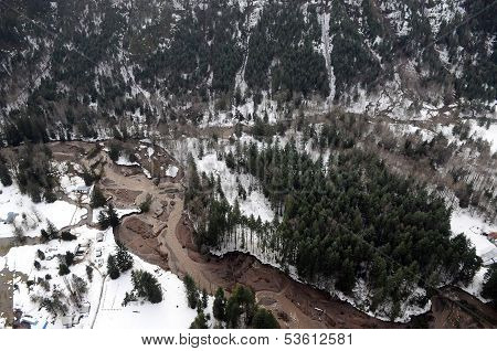 Mudslides scar the hillsides of Washington state following heavy rain on top of snow. poster