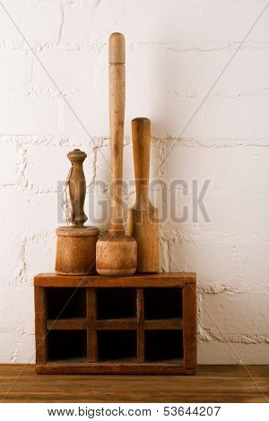 retro kitchen utensils  mashers on old wooden spice box in rustic style