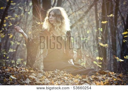 Young Woman Sits In The Fairy Wood