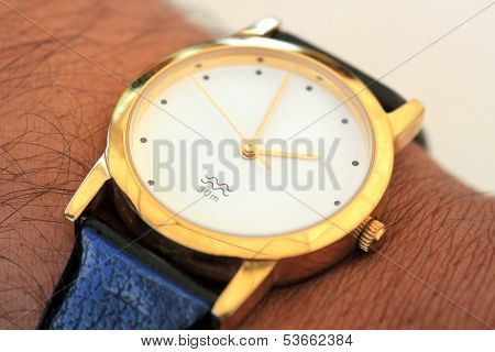 Golden Modern Wrist Watch Showing Time As 2Pm