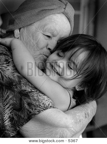 Child Hugging Her Grandmother