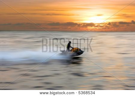 Riding Jetski At Sunset