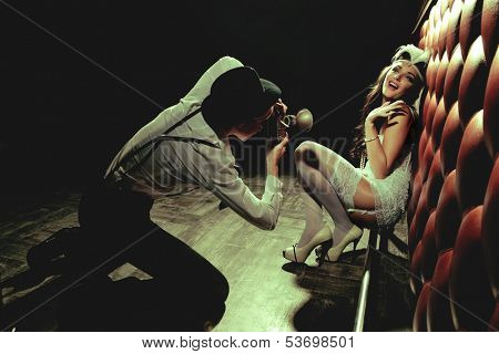Photographer is taking a picture of a beautiful cabaret girls poster
