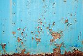 Rusted blue painted metal wall. Detailed texture for background poster