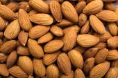 The ripe cleared raw golden almonds background poster