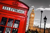 Red telephone booth and Big Ben in London, England, the UK. The symbols of London on black on white sky. poster