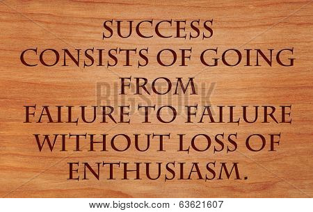 Success consists of going from failure to failure without loss of enthusiasm - quote by Winston Churchill on wooden red oak background