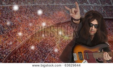 Bassist plays at a live concert against the backdrop of the stadium