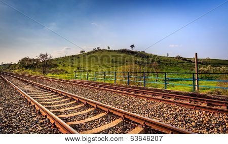 Railway and green hill in Gorzow Wielkopolski, Poland. Landscape photograpy. poster