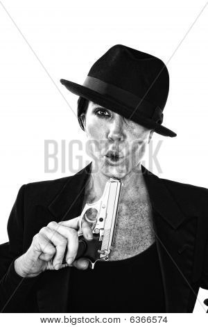 Woman Blowing On The End Of A Smoking Gun